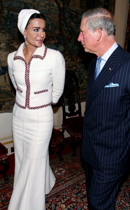 Sheikha Mozah during an official visit to Clarence House in central London. She wears a Chanel couture and accessories from Bucellati that included her earrings and bracelet.